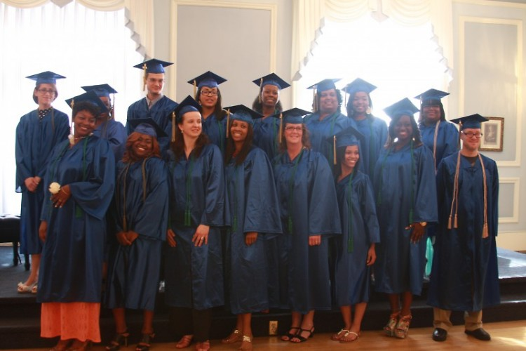 Our 2013 graduates shoot a smile before walking across the stage at graduation.
