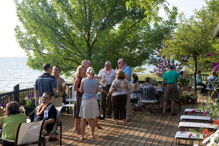 Guests enjoying an evening on Lake Michigan at the summer home of Peter & Joan Secchia.