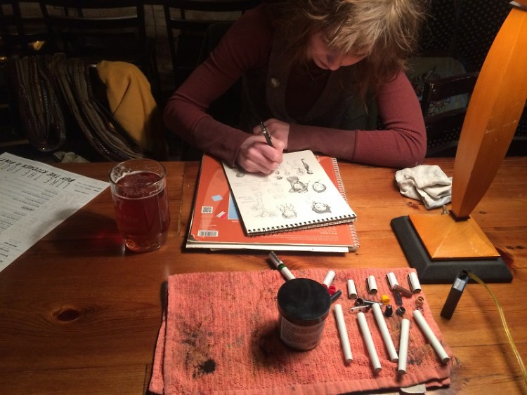 Kat Ehlich works on ink sketches.