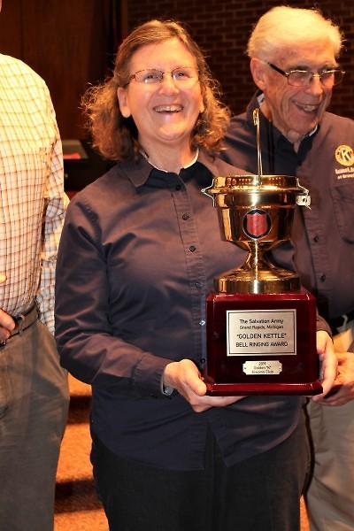 Golden K Kiwanis President Gloria Cangelosi receives the Golden Kettle Award