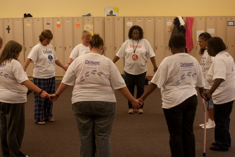 Women at Open Door form a circle at night to share their successes and difficulties of the day.