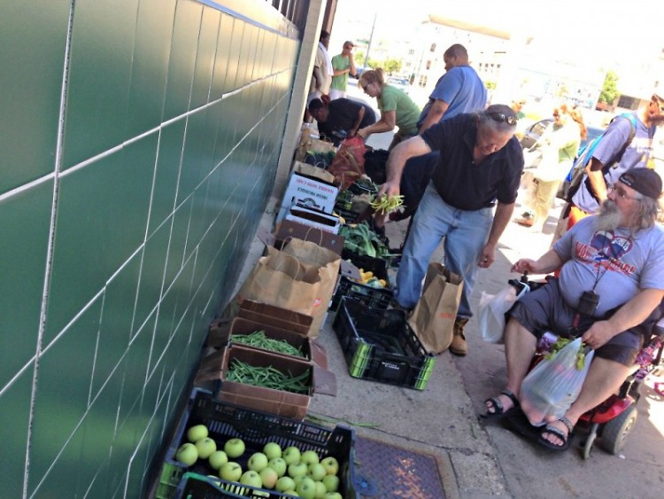 Neighbors helping each other at the Heartside Gleaning