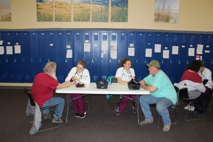 Calvin College nursing students attend to our patrons' needs