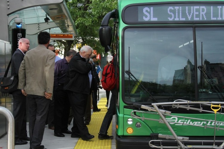 Passengers board the Silver Line in downtown Grand Rapids.