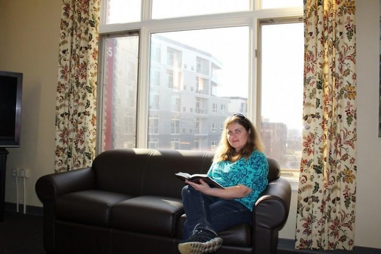 Katheryn reading her Bible in the Open Door Women's Center