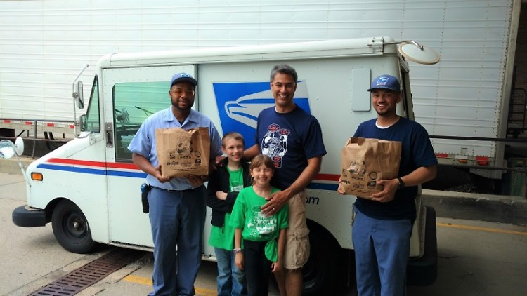 Letter carriers and helpers display donated food at the Kentwood Post Office branch, Saturday, May 13.