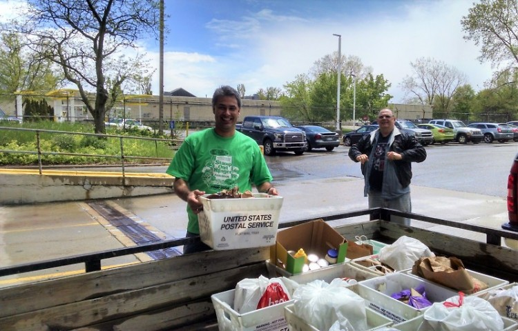 NALC Branch 56 president Kyle Inosencio, left, unloads donations during the 2016 Stamp Out Hunger Food Drive.
