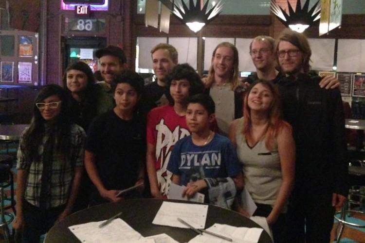 Andy Angelo Press Club members pose with La Dispute band members