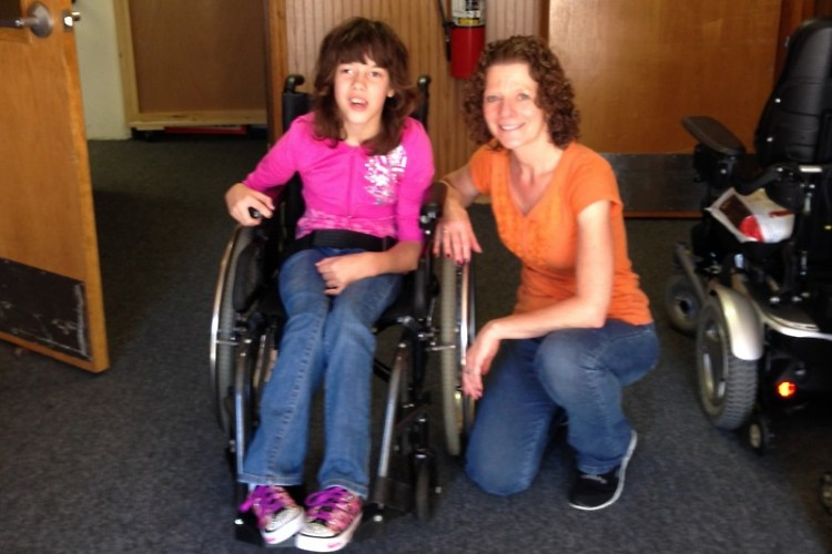 These awards raise funds to help wheelchair recipients like Lizzy (pictured with staff member Liz).