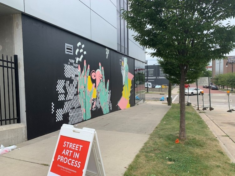 """""""Love Yourself,"""" a new Heartside mural by Bryan Kosciolek, invites passersby to reflect on community self-care"""