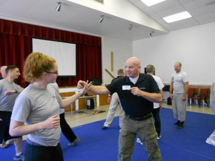 Instructor Craig Gray demonstrates self-defense technique.