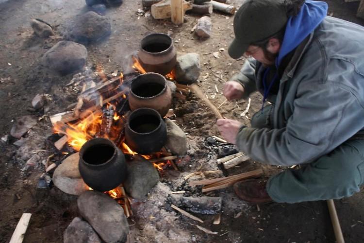Erik Vosteen boils maple sap at Blandford Nature Center in unglazed pottery.