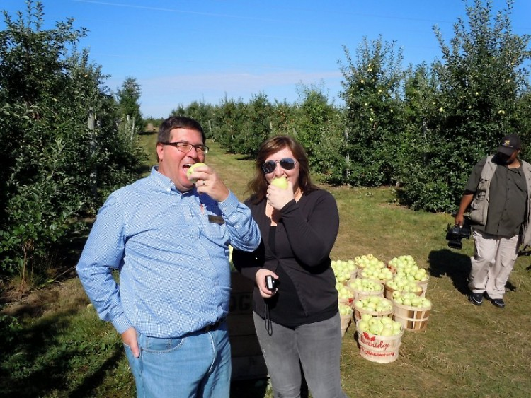 Mark Christianson of Feeding America and Melissa Dubridge of Riveridge Produce Marketing sample some Ginger Golds.