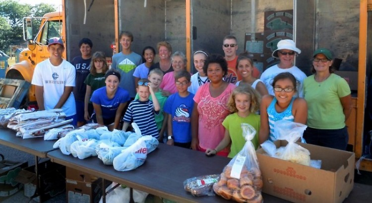 Volunteers from St. Thomas the Apostle coordinate Mobile Pantries at Congress Elementary each summer.