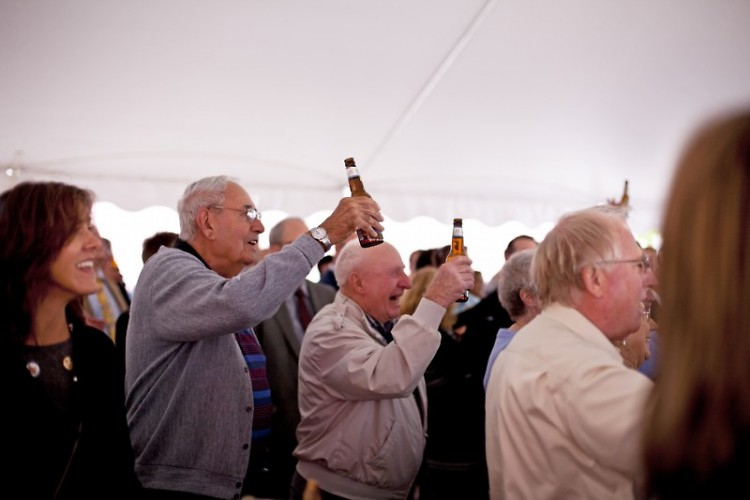The crowd toasts to the new development