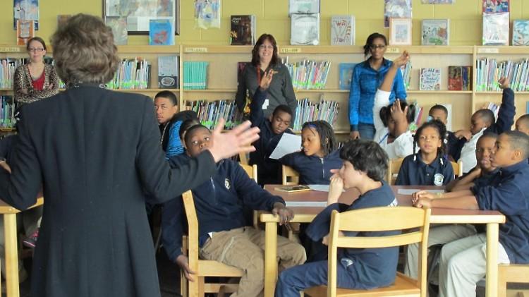 Author Sue Stauffacher speaks with MLK Leadership Academy students