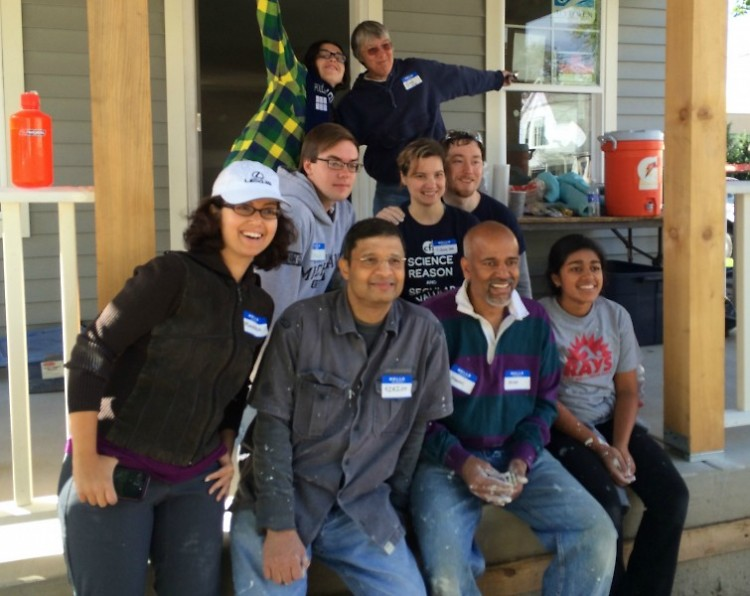 Interfaith community working together on a Habitat for Humanity project