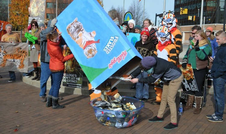 Forest Heroes volunteers dump over 5,000 petitions from across Michigan into a cereal bowl to deliver to key Kellogg's employees