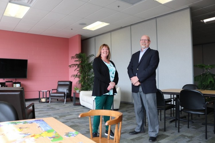 """Bethlehem Intergenerational Center Director Sue Davidson (left) and Pastor Jay Schrimpf (right) pose in the new """"Rose Room."""""""