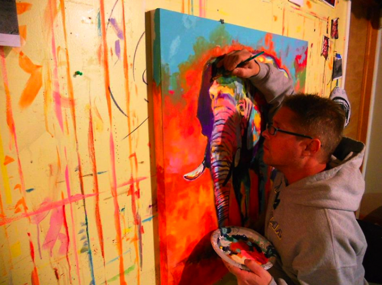David Warmenhoven works on a painting