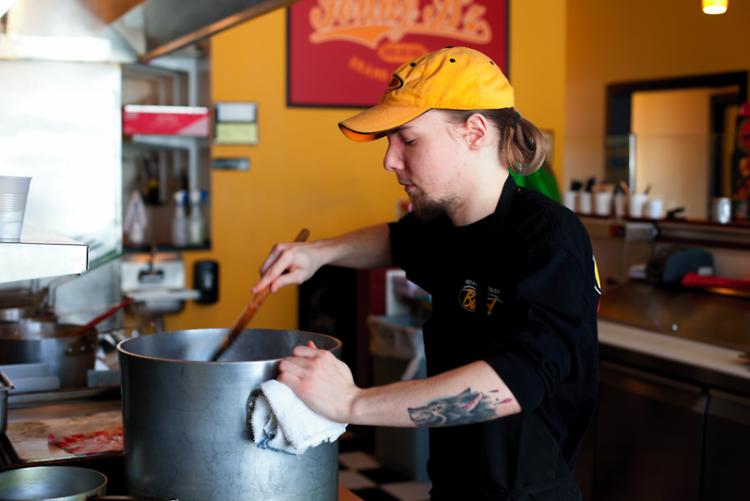 Employee Nick Kibilko preps kitchen before opening