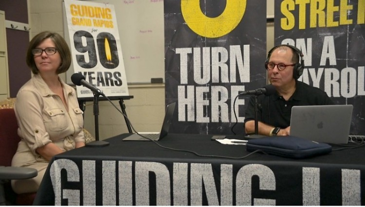 Development Director Starla McDermott and West Michigan radio personality Phil Tower record the podcast's introductory episode.