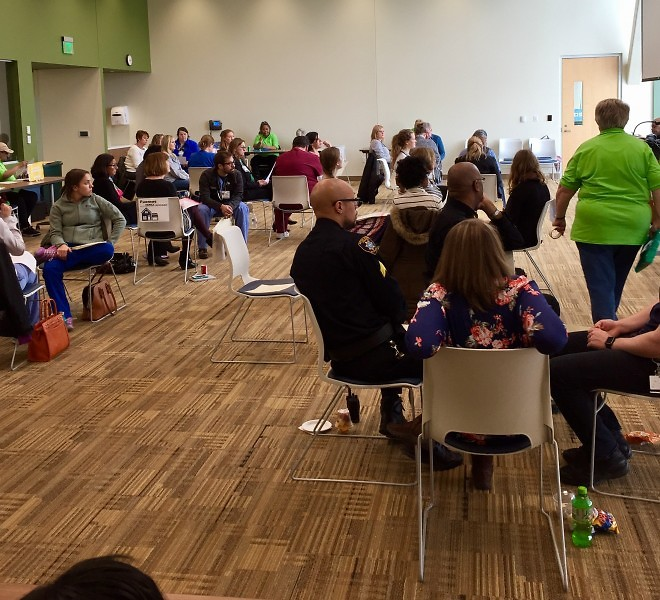 "Health professionals gather in ""families"" in preparation to experience a ""month"" in poverty."