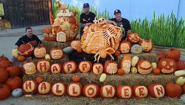 Pumpkin carver, Greg Butauski with some of his carvings.