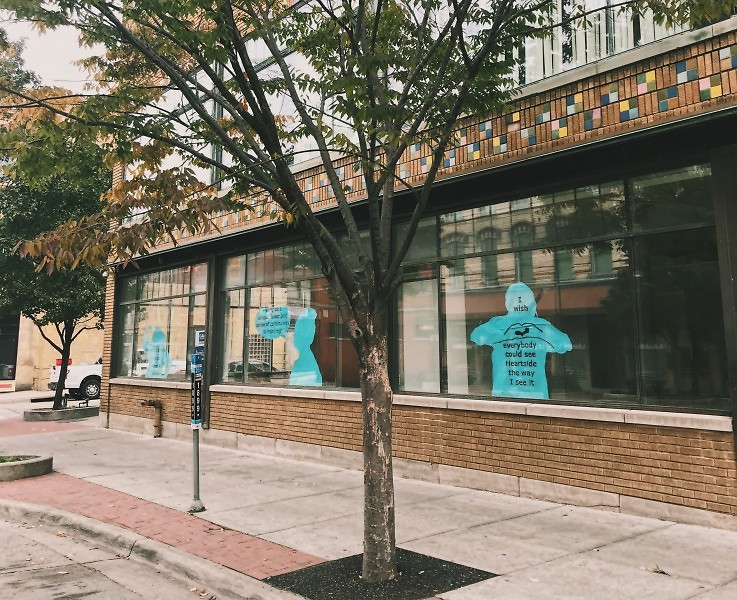 """Proudly displayed on S. Division, Felisa Pratt's silhouette (right) says """"I wish everyone could see Heartside the way I see it."""""""