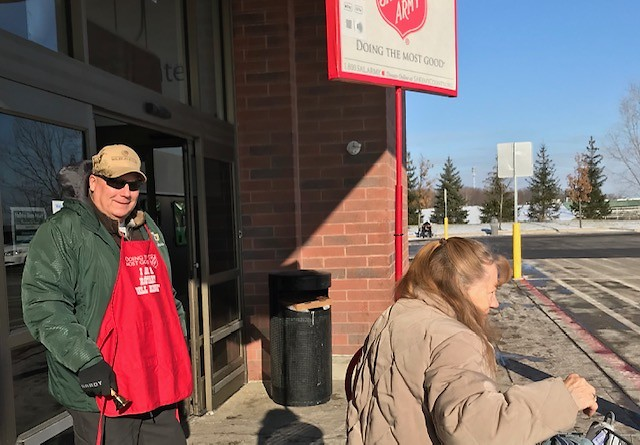Comstock Park Rotarians rang bells at the Alpine Street Walmart