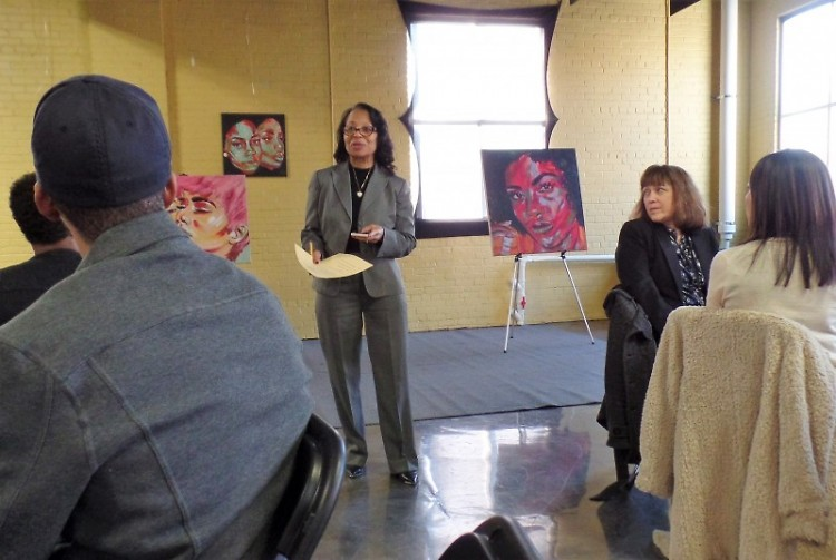Velicia Humes, Ed.D. and consultant to MCOLES, addresses citizens at LINC Gallery