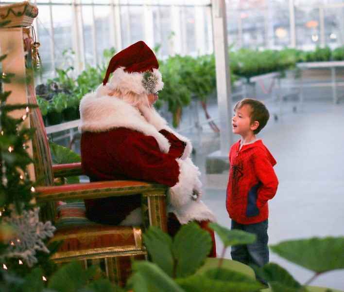 Santa talks with a visitor