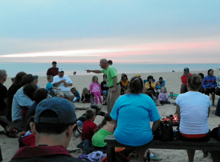 Warren Dunes State Park Explorer Guide Mike Latus tells a campfire story on the beach.