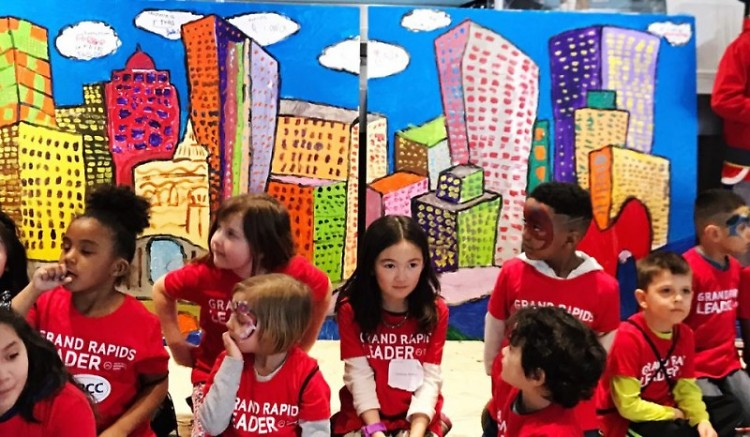 Erica Soto led the Kids Summit, where attendees painted the Grand Rapids' skyline.