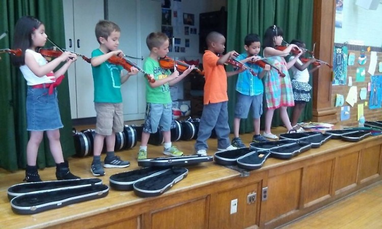 Student performing at Congress Elementary School