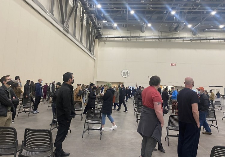 Patients in line for vaccine shots at the West Michigan Vaccine Clinic inside DeVos Place.
