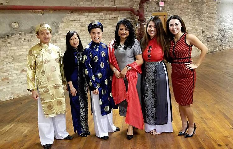 Members of the local Asian community in traditional dress