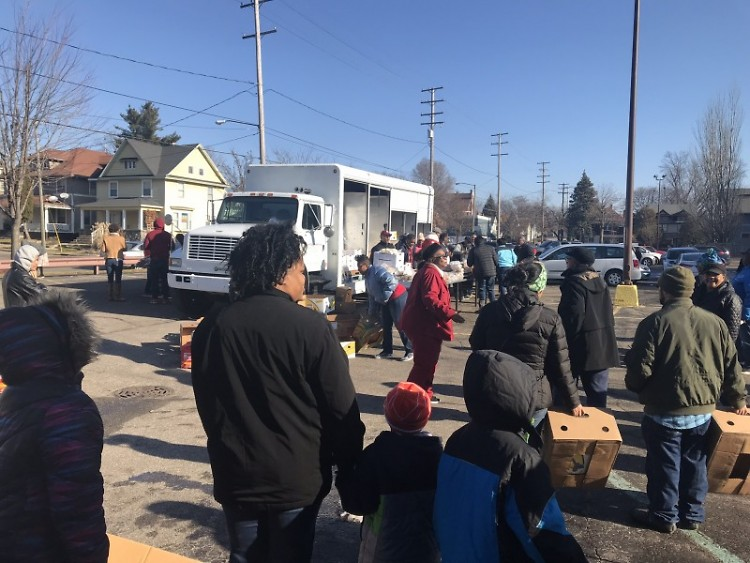 Neighbors wait in line to receive food at a January Mobile Food Pantry.