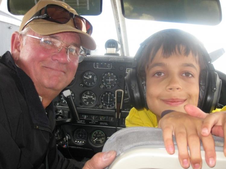 Jack Lewis and Daniel Urban in Lewis' plane's cockpit.