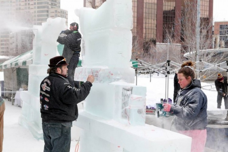Local couple creating an ice sculpture together.