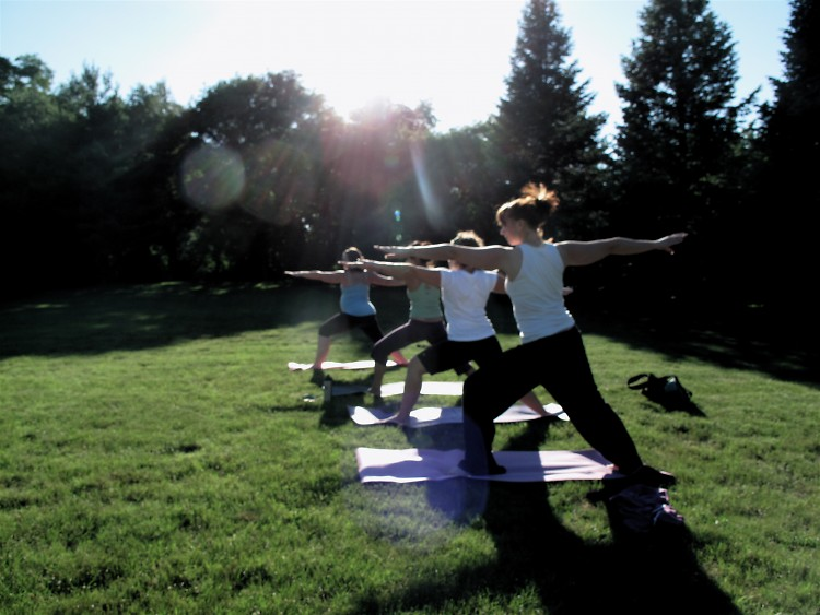 Students hold a variation of warrior pose.