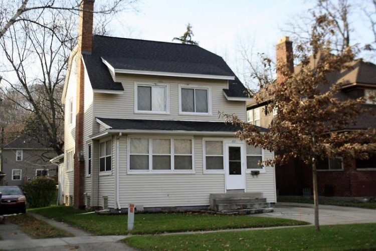 Home near Lincoln Park, formerly family owned with a front porch, now build out to maximize square footage to rent to students.