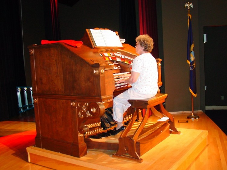 Paula Sullivan, one of the Museum's faithful volunteers who plays the organ for Story Time with the Mighty Wurlitzer on Mondays.