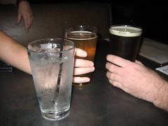 Drinking water at the bar