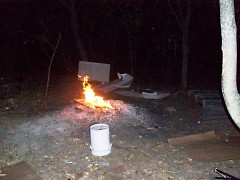 Picture of campfire at the homeless encampment. This is located in the middle of the city.