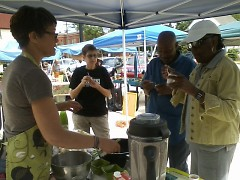 Community members shopping at the Southeast Farmers Market