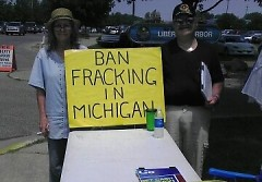 Committee to Ban Fracking in Michigan petitioners at a booth in Bay City.
