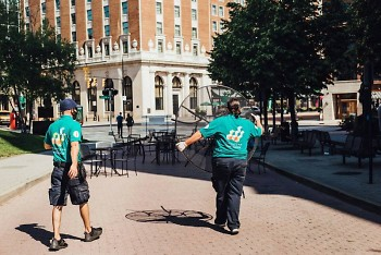 Grand Rapids' Downtown Ambassadors installed tables and chairs for its downtown social zones on Friday.