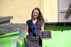 Autumn Sands shows off awards garnered for BarFly's efforts in sustainability