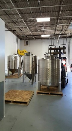Brewing equipment being moved into place